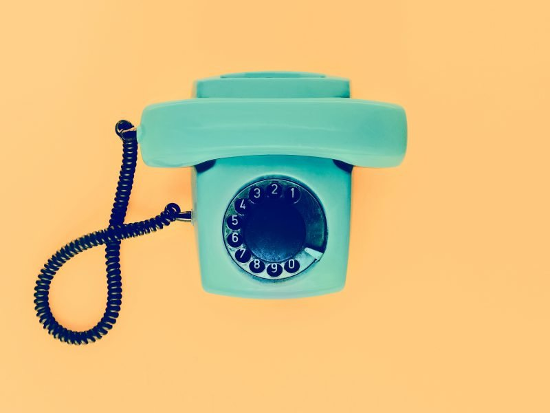 Old vintage phone on a yellow background
